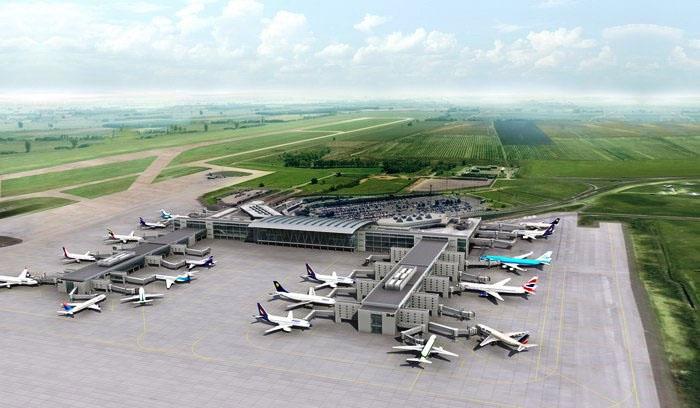 Korábban publikált látványterv a kettes terminálból kinyúló utasmólókról. A pályázat a 2B terminálhoz csatlakozó móló megépítésére szól (a képen a jobb oldali). A most publikált látványterv szerint megépülő mólóból hét utashíd nyúlik majd ki, melyből három olyan utashíd lesz, mely a szélestörzsű repülőgépek két ajtajára is csatlakozhat majd. (Forrás: Budapest Airport) | © AIRportal.hu